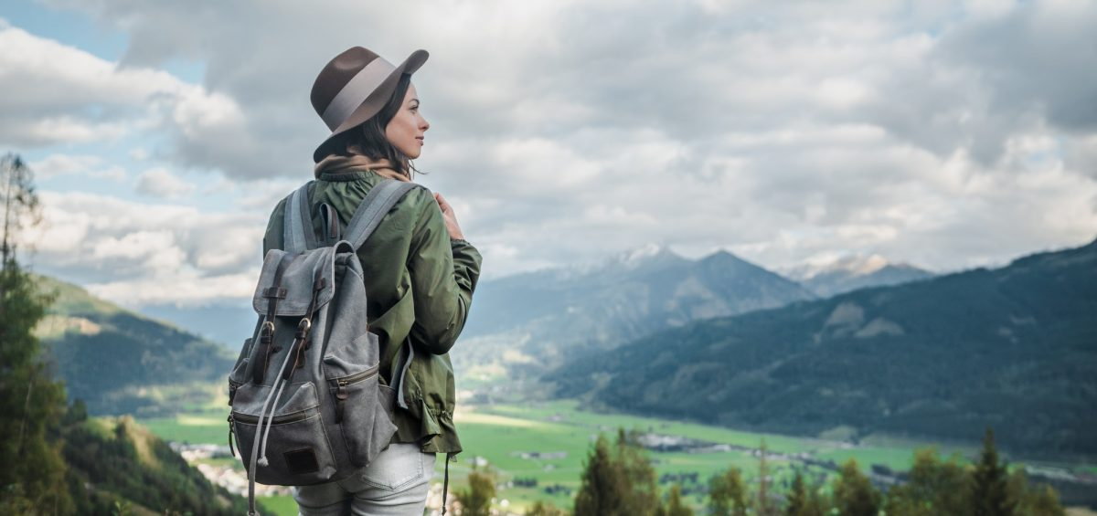 Young woman with a backpack in Austria